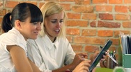 Businesswomen with tablet computer working in the office, steadicam shot HD Stock Footage