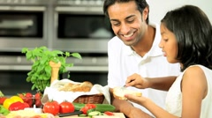 Ethnic Father & Daughter Preparing Food Stock Footage