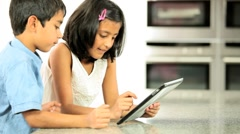 Ethnic Siblings Using Wireless Tablet Stock Footage