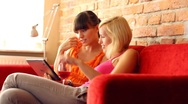 Happy female friends with tablet computer in home, steadicam shot HD Stock Footage