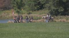 Stock Footage - Confederate Infantry March past pond - Lady sends them off Stock Footage
