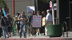 Protesters walk on the sidewalk - Occupy Los Angeles - stock footage