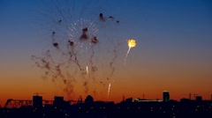 Firework show over the river in evening city, timelapse Stock Footage