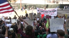 Protester waves a flag at City Hall - Occupy Los Angeles - stock footage