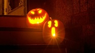 Stock Video Footage of Halloween Pumpkins Glow in the Night with Lightning – HD