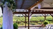 Wedding ceremony decorations overlooking vineyard Stock Footage