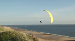 Parasailers over beach Stock Footage