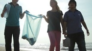 Stock Video Footage of Teenagers with adult Volunteering Beach Cleanup
