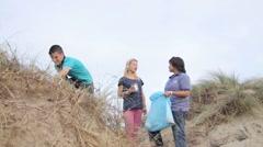 Teenagers Volunteering Beach Cleanup Stock Footage