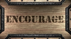 Encourage on wooden stamp Stock Footage