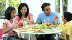 Young Ethnic Family Enjoying a Healthy Meal Stock Footage