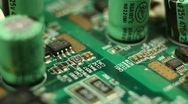 Stock Video Footage of Motherboard Resistors Circuitboard Manufacturing Microcontroller Engineering