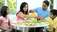 Ethnic Family Eating Healthy Meal Stock Footage