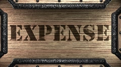 expense on wooden stamp - stock footage