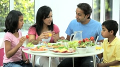 Attractive Asian Family Eating Together - stock footage