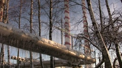 Icicles on power electric station pipes 3 Stock Footage