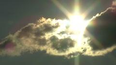 Hidden sun dark cloud Stock Footage