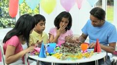 Asian Family Enjoying Delicious Birthday Cake - stock footage