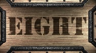 Eight on wooden stamp Stock Footage