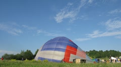 Aerostats are filled with hot air and take off Stock Footage
