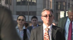 Business crowd in suit and tie walk home in anonymous location - stock footage