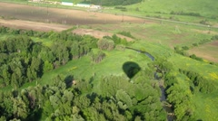 Aerostat cast a shadow on forest near river Stock Footage