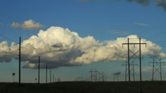 Cumulus Clouds over Power Lines Timelapse Stock Footage