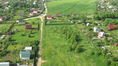 Flight above cottages near Moscow in hot air balloon Stock Footage