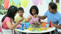Young Asian Family Sharing Party Birthday Cake Stock Footage