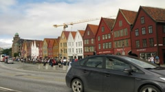 Tourists and vehicle traffic on Bryggen district Stock Footage