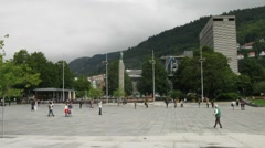 People pass through plaza in Norwegian town Stock Footage