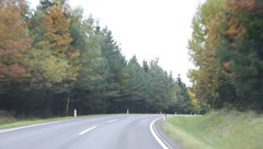 Stock Video Footage of Riding through the forest in autumn