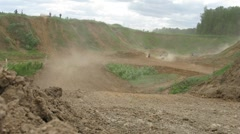 Raiders run in dust clouds during enduro race Stock Footage
