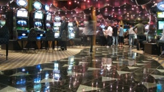 People pass through casino on board of cruise liner Stock Footage