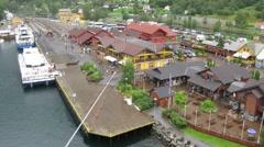 Ships at pier in little Norwegian village Stock Footage