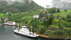 Ferry ship stationed at pier in Flom village Stock Footage