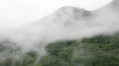 Little waterfalls in mist covered mountains Stock Footage