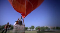 Red ballon warming up at the European Ballon Festival at Igualada-Spain Stock Footage