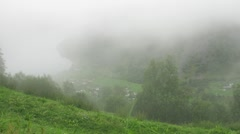 Little Norwegian village covered in fog Stock Footage