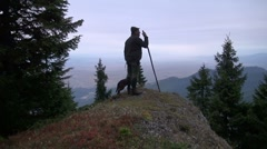 Hunter with his dog on a rock Stock Footage