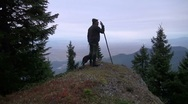 Stock Video Footage of hunter with his dog on a rock