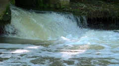 Water plunges into the river through a sluice, slow motion, looping, Stock Footage