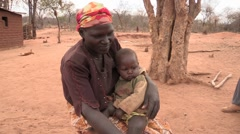 Kenyan Woman and Her Twins Stock Footage