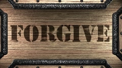 forgive on wooden stamp - stock footage