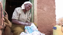 Kenya: Washing Clothes by Hand Stock Footage