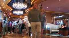 Passengers pass by in restaurant on board of cruise ship Stock Footage