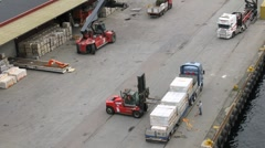 Forklift truck unload cargo from truck, time lapse Stock Footage