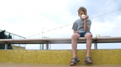 People pass by boy who drink his cup and go away, time lapse Stock Footage