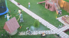 Children play pirates on dacha, top-down view, time lapse Stock Footage