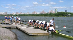 Men eights teams take off from pier during Big Moscow regatta Stock Footage